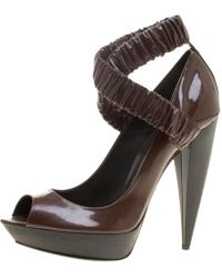 33ef88d569d Lyst - Prada Patent Leather and Wood Criss-cross Wedge Sandals in Black