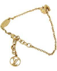 Louis Vuitton - Lv & Me Gold Tone S Soft Bracelet - Lyst