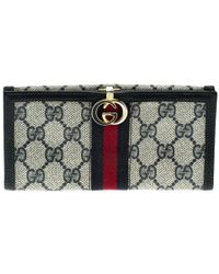 0afcc10934c6 Lyst - Gucci Beige and Cocoa Gg Canvas Snap Button Wallet in Brown
