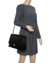 fe76f47f411c Chanel - Black Quilted Patent Leather Maxi Classic Double Flap Bag - Lyst