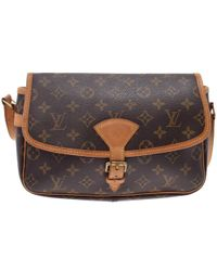 454947ca7bc7 Lyst - Louis Vuitton Pre-owned Cloth Crossbody Bag in Brown