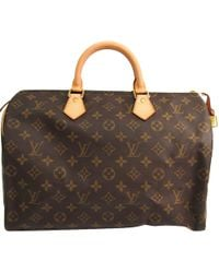 c5aa5f959fe0 Lyst - Louis Vuitton Vintage Monogram Canvas Speedy 40 in Brown