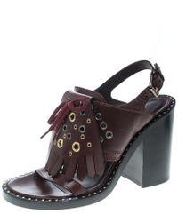 2446193cc615 Burberry - Leather Beverley Eyelet Fringe Detail Block Heel Sandals - Lyst