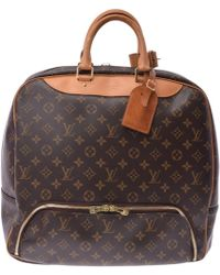 Louis Vuitton - Monogram Canvas Evasion Travel Bag - Lyst