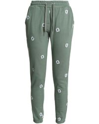 Zoe Karssen - Embroidered Cotton-jersey Track Trousers Leaf Green - Lyst
