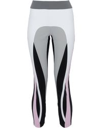 NO KA 'OI - Cropped Color-block Stretch Leggings - Lyst