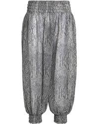 Norma Kamali - Smocked Snake-print Chiffon Tapered Trousers - Lyst