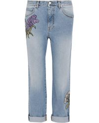 Alexander McQueen - Appliquéd Distressed Mid-rise Straight-leg Jeans Light Denim - Lyst