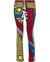 Versace - Printed Mid-rise Slim-leg Jeans - Lyst