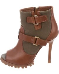 de34a660be08 Lyst - Tory Burch Perforated Leather Wedge Booties in Brown
