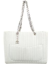 8628a31c6573 Lyst - Chanel Mademoiselle Lock Straw Tote Natural in Metallic