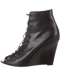 c64f31a92bc Lyst - Givenchy Peep-toe Wedge Booties Black in Metallic