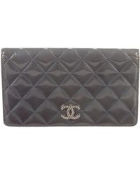 53a18bf66949 Lyst - Chanel Camellia Zip-around Wallet Pink in Metallic