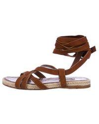 f890aac576f8 Lyst - Miu Miu Miu Patent Leather Embellished Sandals in Black