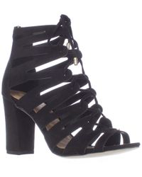 6b7736a6352 Madden Girl Banerrr Strappy Caged Lace Up Sandals in Black - Lyst