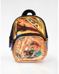 1608395d1539 Lyst - adidas Originals Mini Iridescent Backpack in Metallic