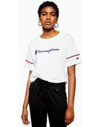 7f3aacbd Champion - Stripe Sleeve Crop T-shirt By - Lyst