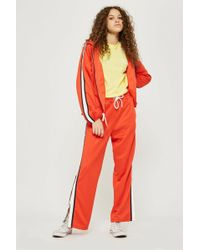 TOPSHOP - Orange Popper Track Pants - Lyst