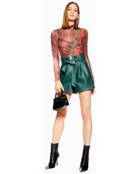TOPSHOP - Leather Look Zip Shorts - Lyst