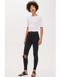 TOPSHOP - Ashed Black Flap Rip Jamie Jeans - Lyst