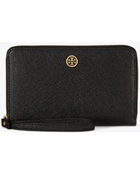 dca5db18fcf Tory Burch Allover Crystal Smartphone Crossbody Wallet in Pink - Lyst
