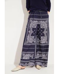 Sacai - Weite Hose mit Print Blau/Weiß - Lyst