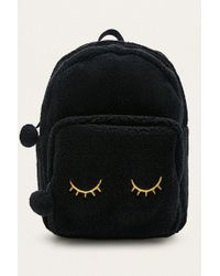 Urban Outfitters - Black Shearling Eyes Backpack - Lyst