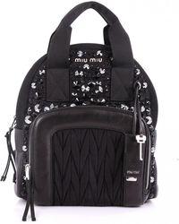 Lyst - Miu Miu Planet-print Canvas Backpack in Black f0b79b924212a