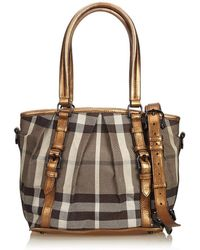 461be96ec550 Burberry - Pre-owned Brown Cloth Handbags - Lyst