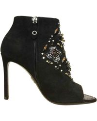 f8fbac16179 Lyst - Louis Vuitton Laureate Lace Up Boots in Black
