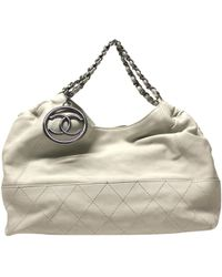 76f5372ddbe Lyst - Chanel Coated Canvas Tote Bag Coco Mark in Black
