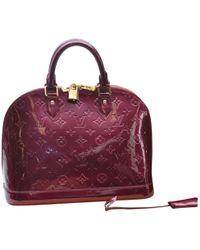 Louis Vuitton - Pre-owned Alma Purple Patent Leather Handbags - Lyst fcb77e854aab1