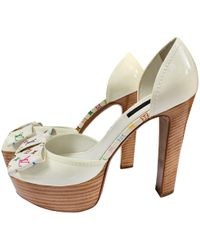 2f081c47829d Louis Vuitton - White Patent Leather Heels - Lyst