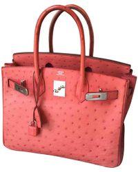 c0dead8c287d Hermès Birkin Ostrich Handbag in Orange - Lyst