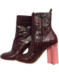 cf7156aad Louis Vuitton Silhouette Leather Ankle Boots in Red - Lyst