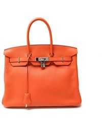 5957d56a57d Hermès - Pre-owned Birkin 35 Orange Leather Handbag - Lyst