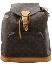Louis Vuitton - Pre-owned Montsouris Brown Leather Backpacks - Lyst