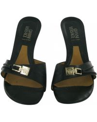 Versace - Leather Mules - Lyst