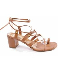 ad73c8f00ae0 Lyst - Valentino Women s Rockstud Ankle-strap Sandals in Natural