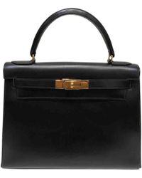 422bda4250 Hermès - Pre-owned Vintage Kelly 28 Black Leather Handbags - Lyst