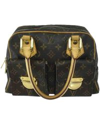 Louis Vuitton - Pre-owned Manhattan Cloth Handbag - Lyst