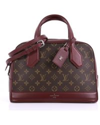 0879f65fdd3b Louis Vuitton - Pre-owned Dora Brown Cloth Handbags - Lyst
