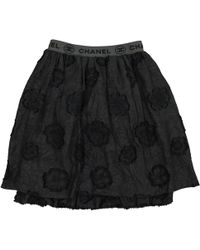 Chanel - Vintage Black Polyester Skirt - Lyst