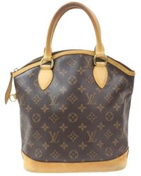 Lyst - Louis Vuitton Caramel Nomade Leather Lockit Bag in Brown d302efe6ee8d1