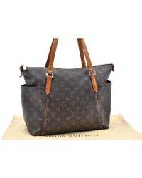 428edfa82a34 Lyst - Louis Vuitton Totally Cloth Handbag in Brown