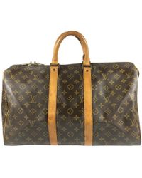 Louis Vuitton - Pre-owned Keepall Brown Cloth Travel Bags - Lyst