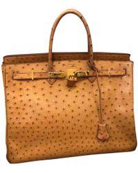 0e4034e04bc7 Hermès Birkin 30 Ostrich Handbag in Orange - Lyst