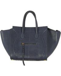 478865311a1 Céline - Luggage Phantom Blue Python Handbag - Lyst