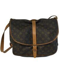 Louis Vuitton - Pre-owned Vintage Saumur Brown Cloth Handbags - Lyst