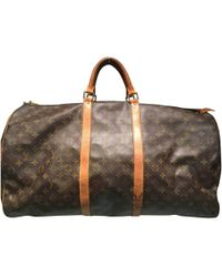 Louis Vuitton - Pre-owned Vintage Keepall Brown Cloth Travel Bag - Lyst